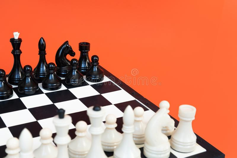 Chess board with figures on blue background top view copy space. Chess game concept. Chess board with figures on blue background top view copy space. Chess game royalty free stock image