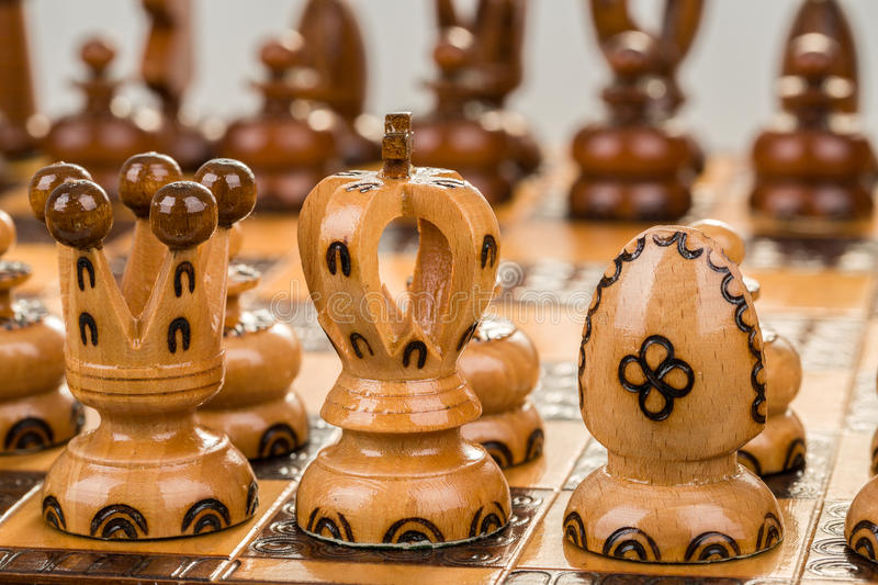 Chess board focus to white king and queen. Closeup chess board focus to white king and queen on white background stock photos