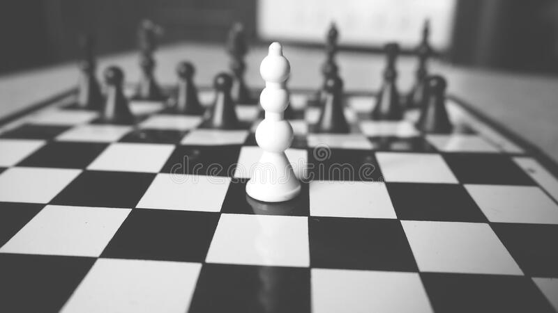 Chess board with focus on white pawn