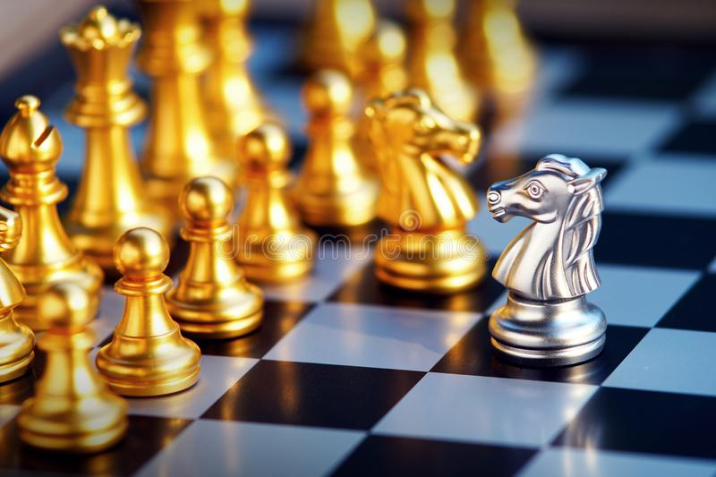 Chess board game, business competitive concept. Chess board game, gold and silver team, business competitive concept stock image