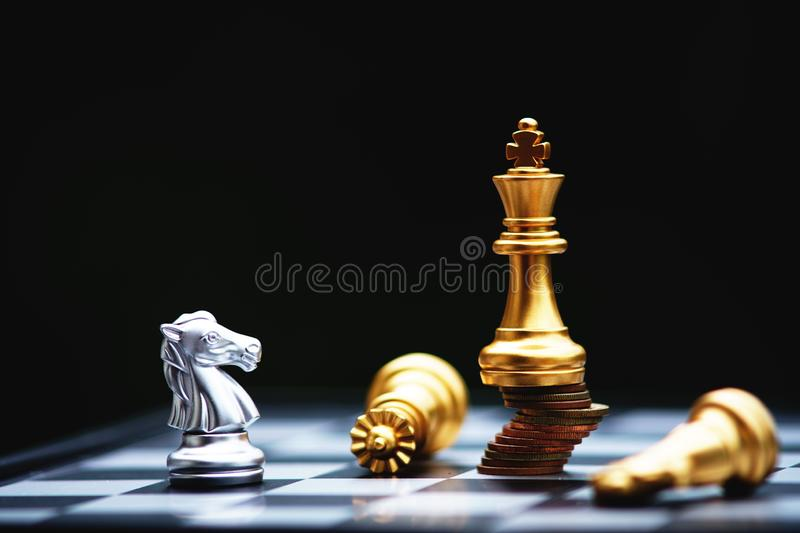 Chess board game, business competitive concept, strong financial capital advantage situation against unstable finance team. Winner and loser stock photo