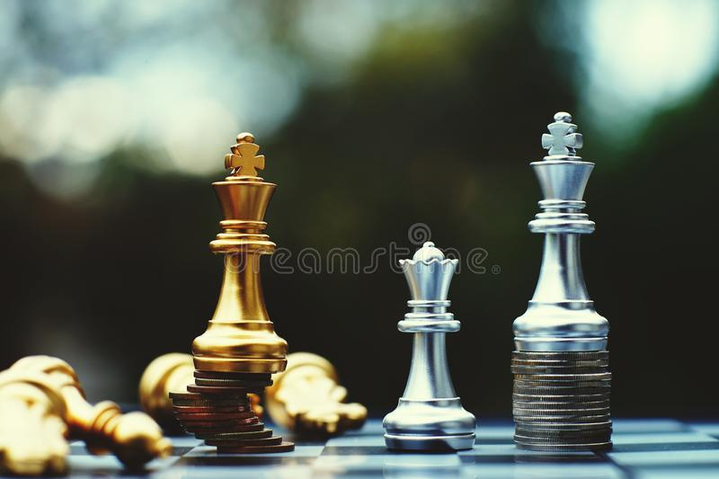 Chess board game, business competitive concept, strong financial capital advantage situation against unstable finance team. Winner and loser stock image