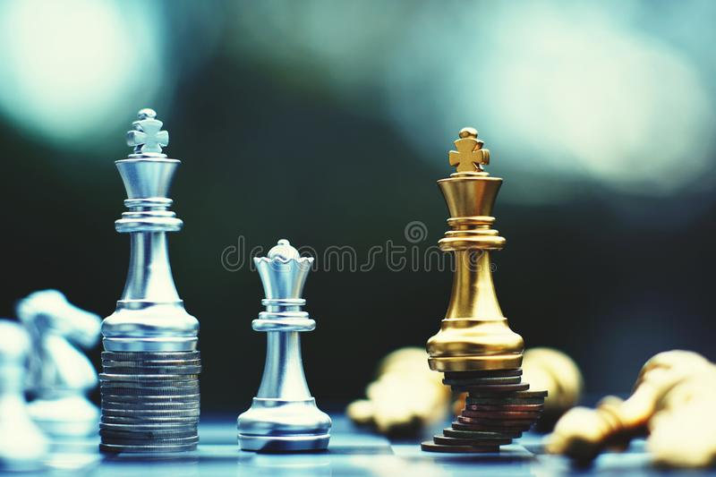 Chess board game, business competitive concept, strong financial capital advantage situation against unstable finance team. Winner and loser royalty free stock image