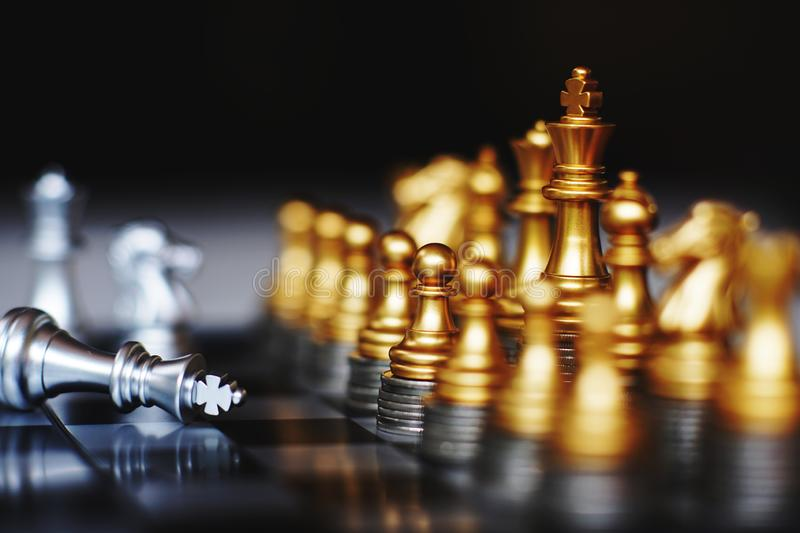 Chess board game, business competitive concept, strong financial capital advantage situation. Winner and loser stock image