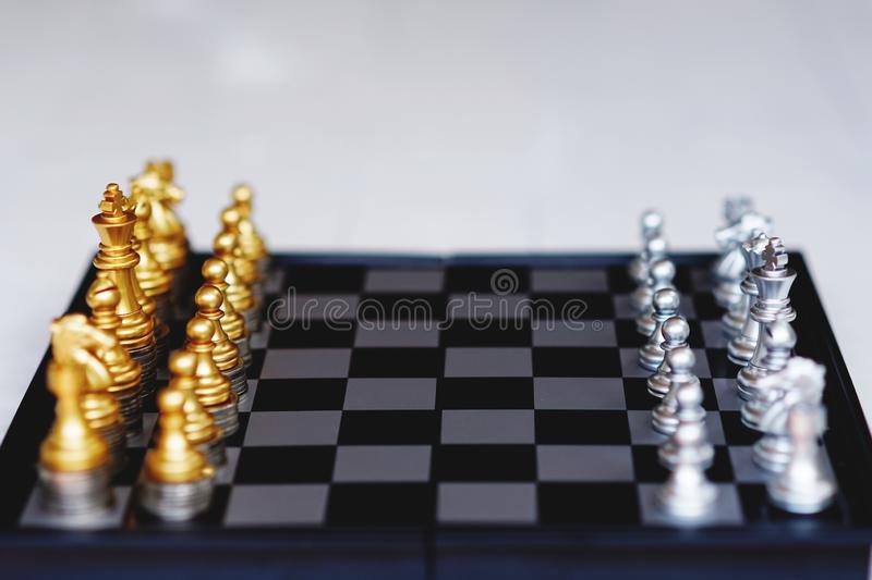 Chess board game, business competitive concept, strong financial capital advantage situation. Winner and loser royalty free stock image