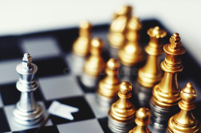Chess board game, business competitive concept, strong financial capital advantage situation. Winner and loser royalty free stock photo