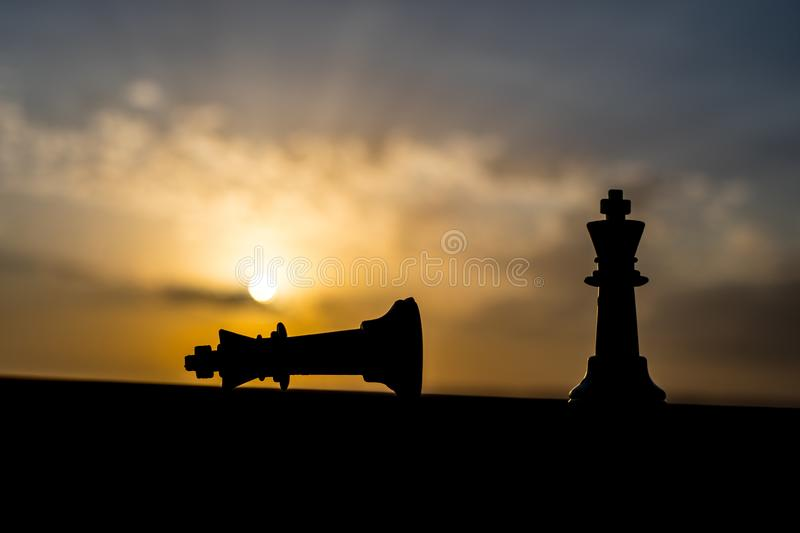 chess board game concept of business ideas and competition and strategy ideas. Chess figures on a chessboard outdoor sunset backgr royalty free stock photo