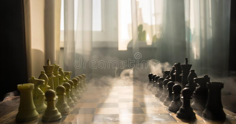 chess board game concept of business ideas and competition and strategy ideas concep. Chess figures on a background with window. stock image