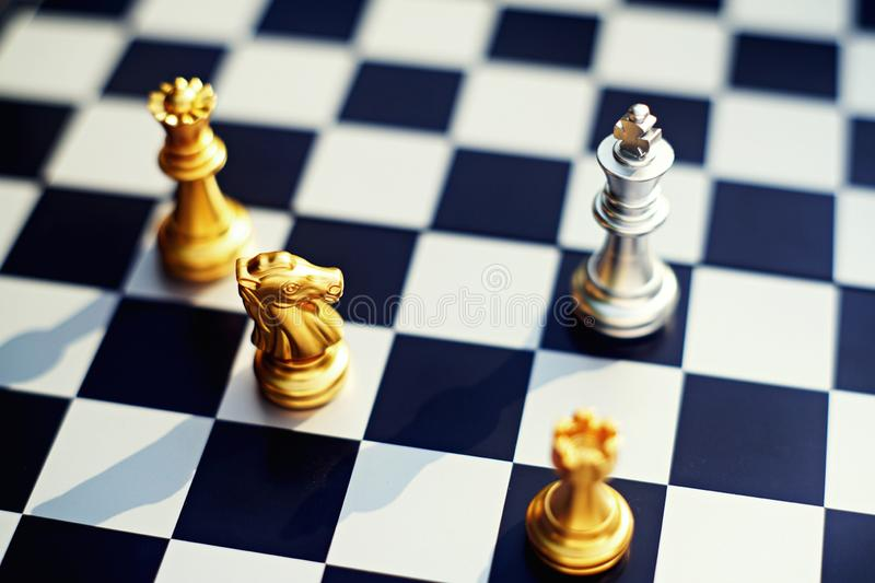 Chess board game, disadvantage king surrounding by enemy with serious situation situation, business competitive concept, copy royalty free stock images