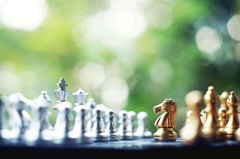 Chess board game. Fighting between silver and golden team. Business competitive and strategy planning concept. Chess board game. Fighting between silver and stock images