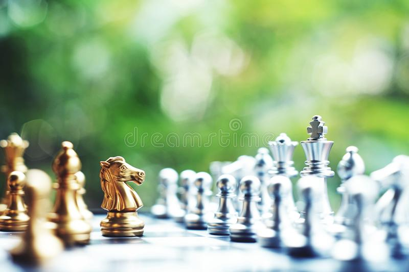 Chess board game. Fighting between silver and golden team. Business competitive and strategy planning concept. Chess board game. Fighting between silver and stock photo