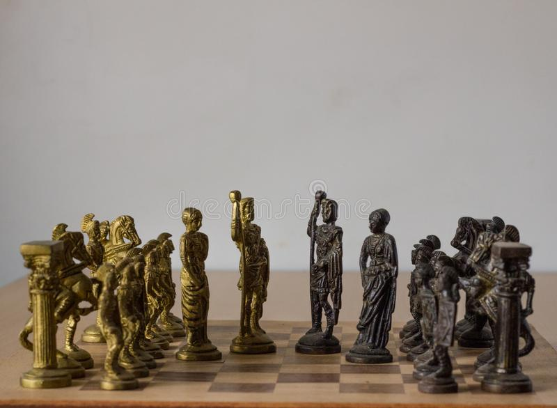 Chess board game, with kings and queens discussing for compromise, peace talks with  their army behind the kings waiting. Chess board game, with kings and queens stock images
