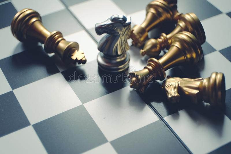 Chess board game. Last knight stand. Winner and leadership concept. Business successful concept stock image