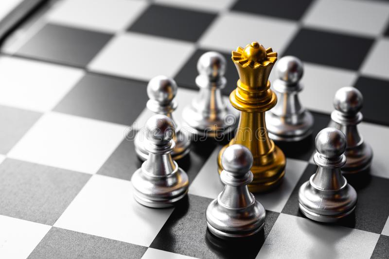 Chess board game. Queen is in trouble been surrounded by enemies. Business strategy and competition stock photo
