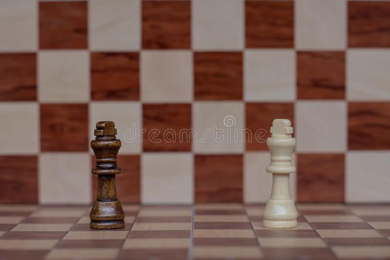 Chess board game. Two king stand confront each other. Business competitive concept. Copy space, achievement, adrenaline, ahead, ambition, brave, challenge royalty free stock images