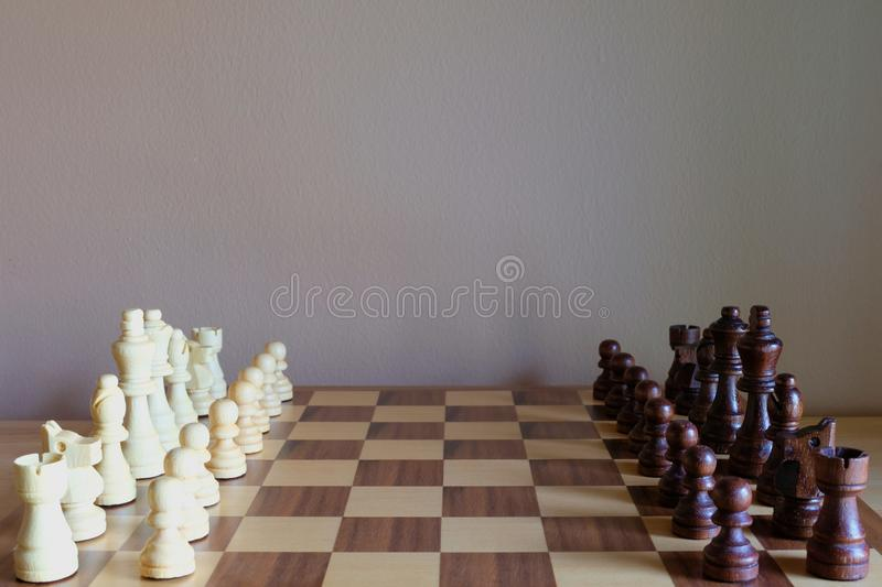 Chess board game. Two teams get ready for fight. Team concept. Copy space for text stock photography