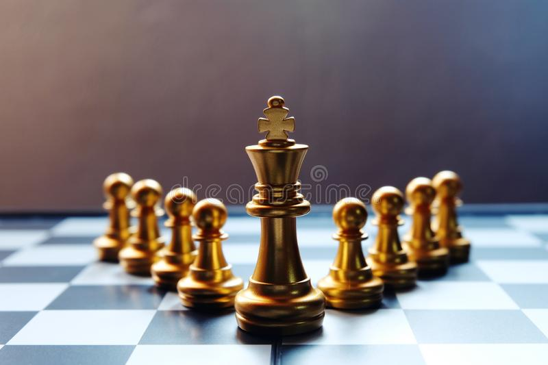 Chess board golden king at the front row. Leadership concept royalty free stock photos