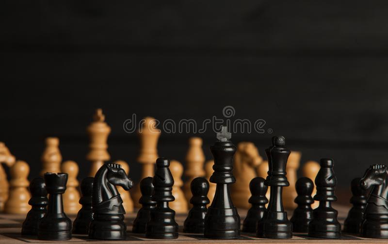 Chess board with chess pieces. Chess on the dark background. Business success concept. Strategy. Checkmate. stock image