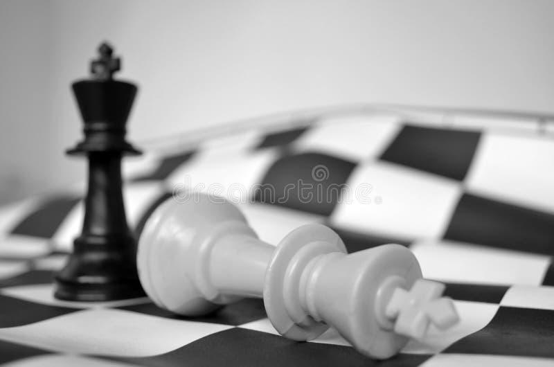 CHESS BOARD - WHITE KING FALLEN stock photography