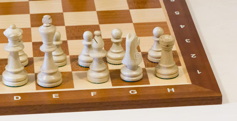 Chess board with white pieces. On a white background stock images