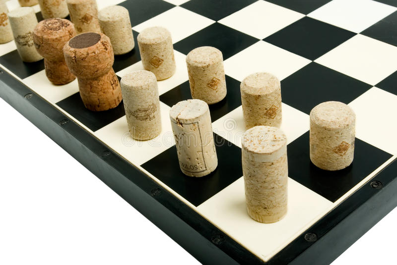 Chess board with wine corks. Close-up chess board with wine corks stock photos