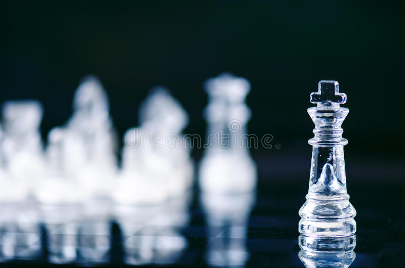 Chess business concept of victory. Chess figures in a reflection of chessboard. Game. Competition and intelligence concept. Chess business concept of victory stock photography