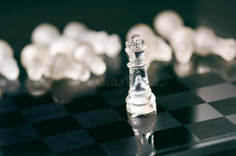 Chess business concept of victory. Chess figures in a reflection of chessboard. Game. Competition and intelligence concept. Chess business concept of victory royalty free stock photo