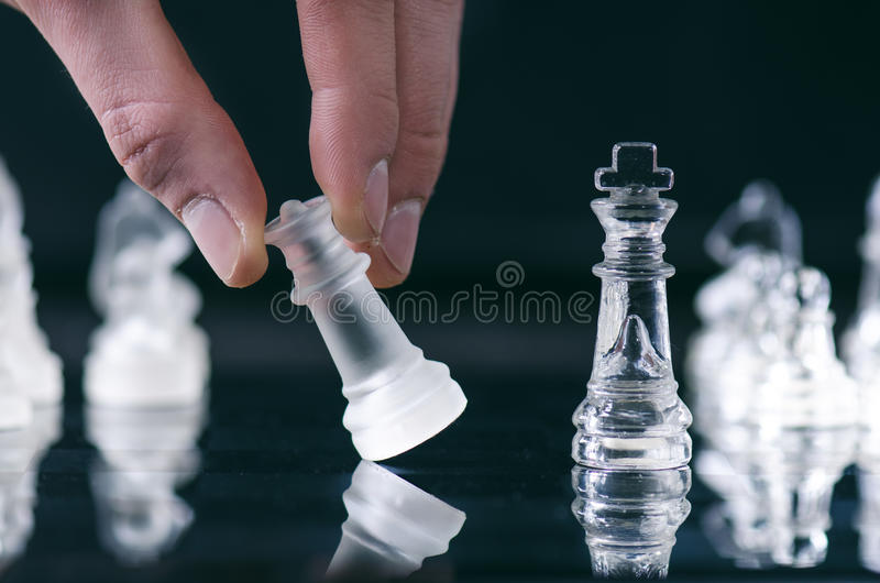 Chess business concept of victory. Chess figures in a reflection of chessboard. Game. Competition and intelligence concept. Chess business concept of victory royalty free stock images
