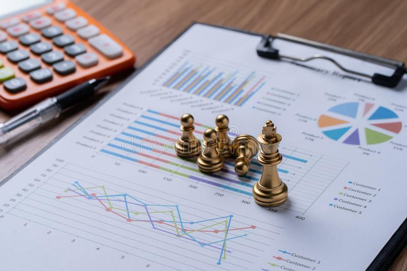 Chess on business report.business and financial stock image