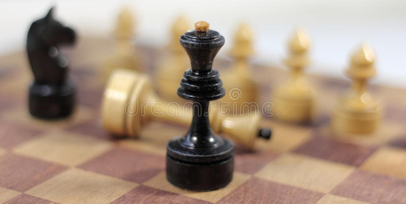 Chess castling. Old shabby chess on chessboard. soft focus stock photo