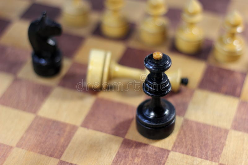 Chess castling. Old shabby chess on chessboard. soft focus stock images