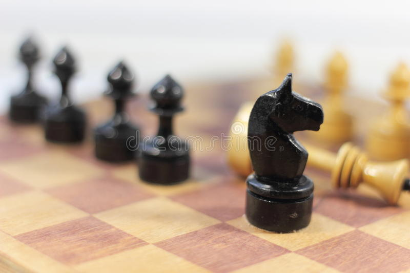 Chess castling. Old shabby chess on chessboard. soft focus stock photos