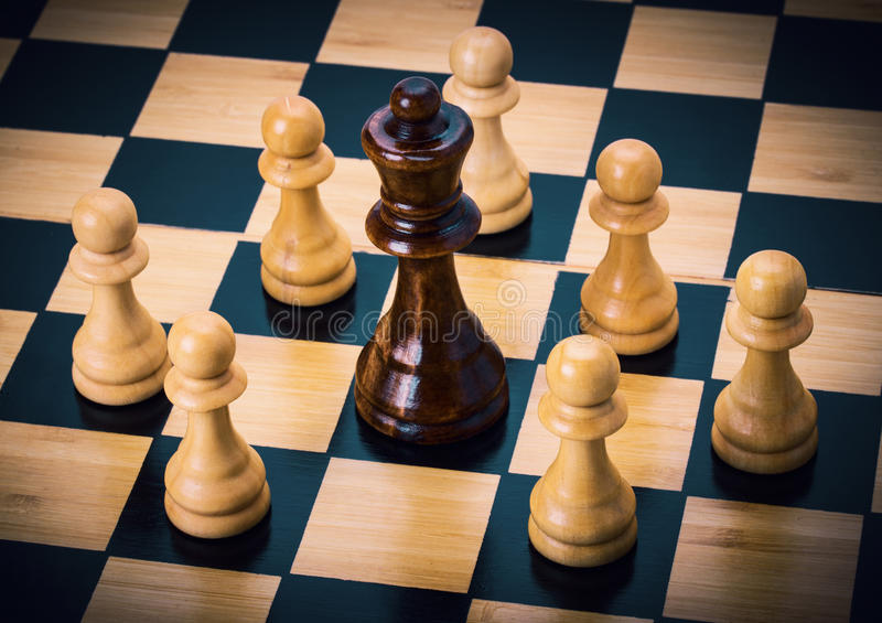 Chess on the chessboard. Wooden chess on the chessboard stock photography