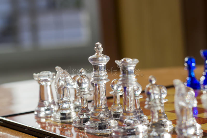 CHESS. A closeup of a chess game with a king piece. Color scheme is white. Use it to represent business strategy, competition or playing a simple game of chess stock photo