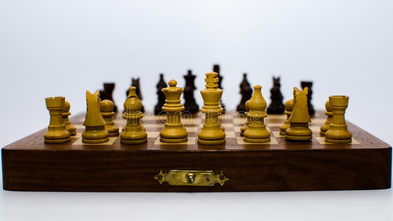 Chess Coins standing opposite to each other royalty free stock image