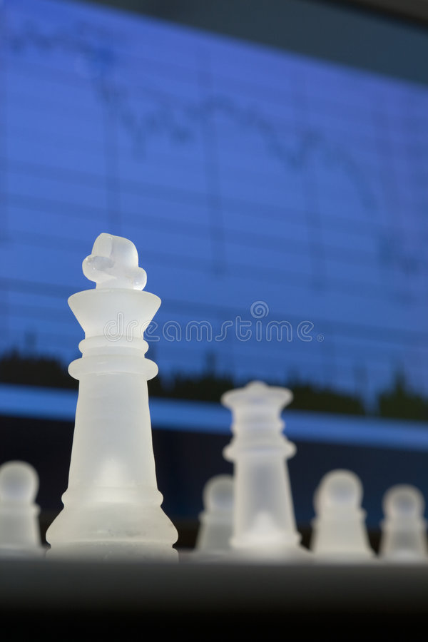 Chess and diagram. Chess and stock market diagram. Business concept stock photography