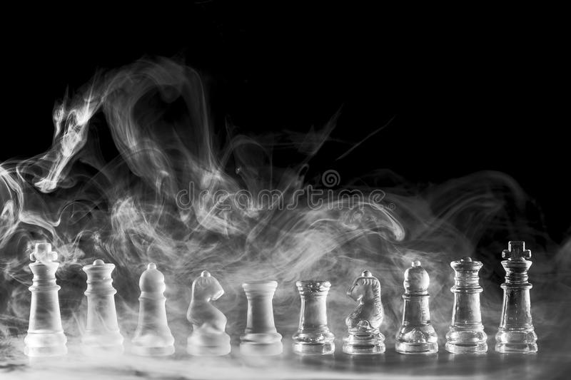 Chess. Each player begins the game with 16 pieces: one king, one queen, two rooks, two knights, two bishops, and eight pawns stock photos