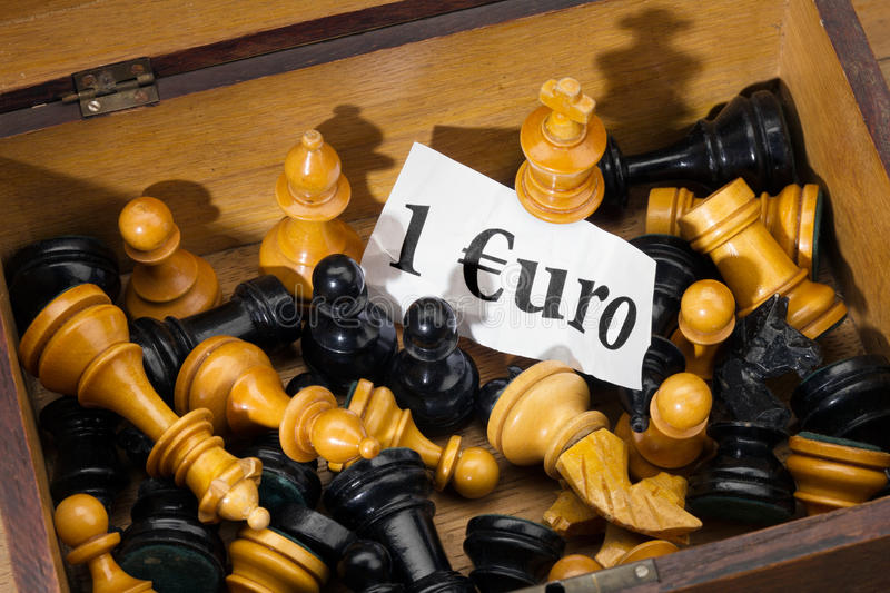 Chess and Euro. Close-up of chessmen as a detail at the flea market for sale as euro crisis symbol image royalty free stock images