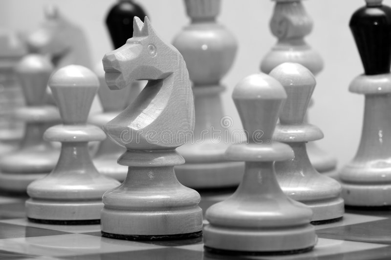 Chess figures. On chess board royalty free stock image