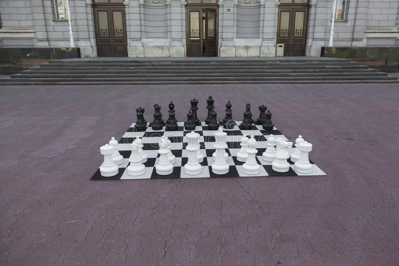 Chess figures ready for the game. Chess figures in the public park ready for the start of the game stock image