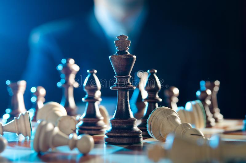 Chess financial, leader strategy in business. Chess financial business strategy concept. Team leader holding chess piece stock image