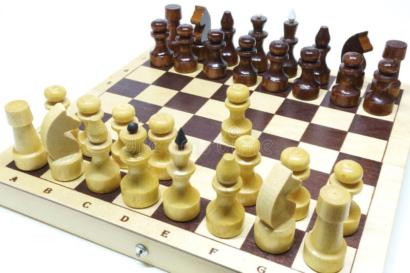 Chess first move. Shallow DOF, focus on white pawn. Isolated on white. Chess, white`s first move. Shallow DOF, focus on white pawn. Isolated on white royalty free stock image