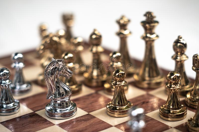 Chess game. A big move to win. Business strategy and competitive concept. Copy space achievement adrenaline ahead ambition brave challenge champion chance royalty free stock photography