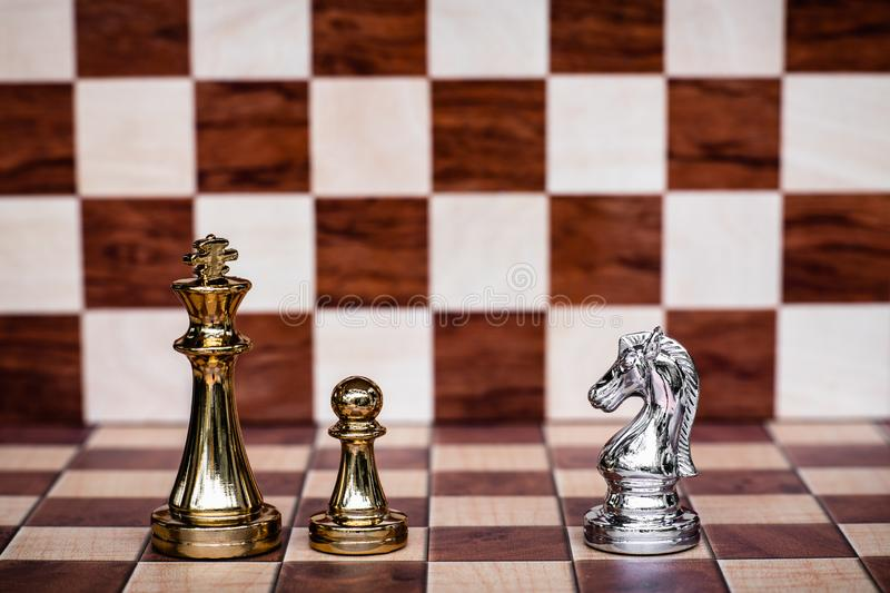 Chess game. Brave knight stand confront enemies. Business strategy and competitive concept. Copy space, achievement, adrenaline, ahead, ambition, challenge stock photo