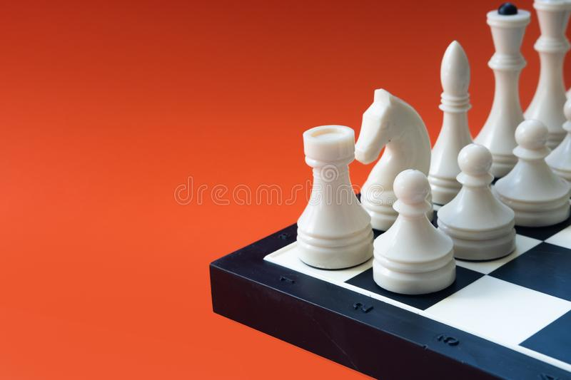 Chess game concept. Chess board with figures on orange background. Copy space. Chess game concept. Chess board with figures on orange background. Copy space royalty free stock photo