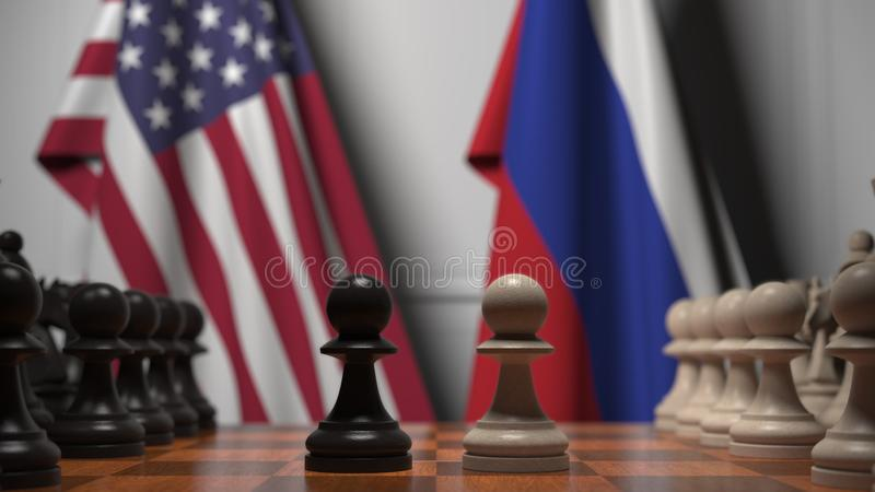 Flags of the USA and Russia behind chess board. The first pawn moves in the beginning of the game. Political rivalry. Chess game. The first pawn moves. Board stock photography
