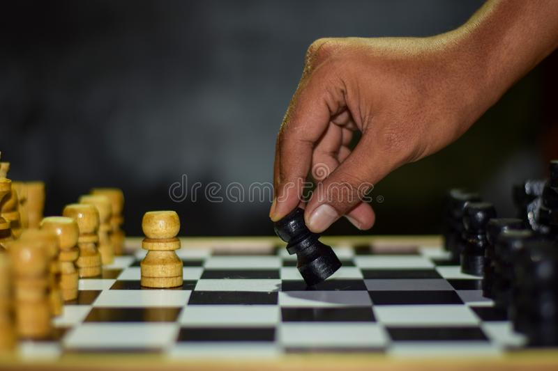 Chess game for ideas and competition and strategy. Photographed on a chessboard stock photography