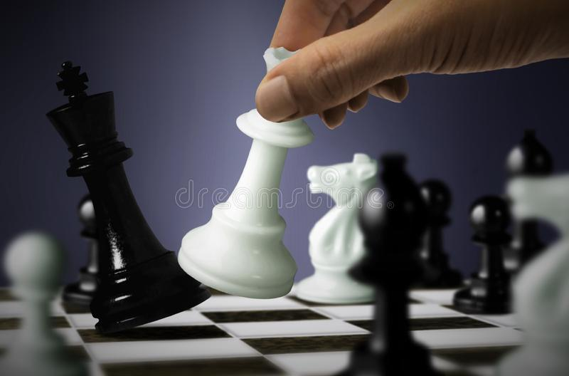 Chess game with King checkmate by Queen. Chess game with black King checkmate by white Queen stock photo