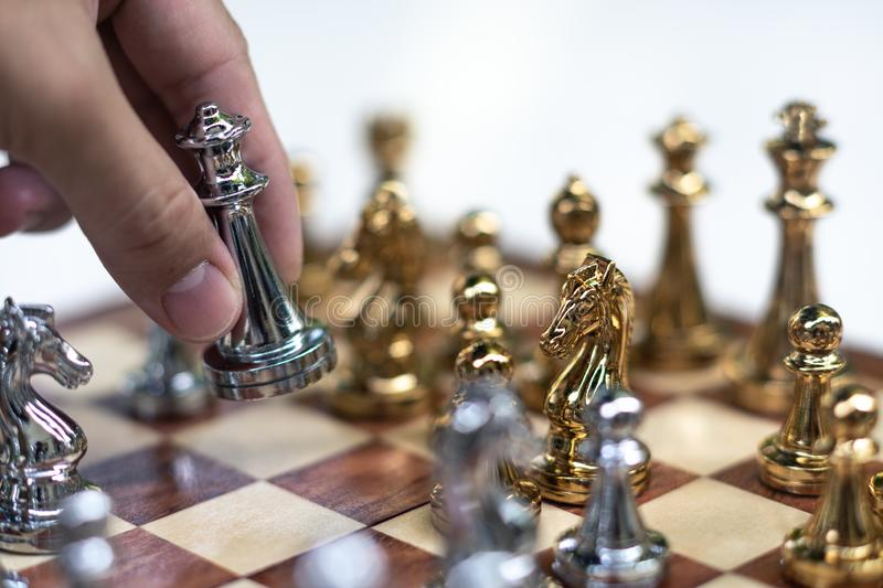 Chess game. King is moving forward to take the advantage of the game. Business competitive concept. Achievement adrenaline ahead ambition brave challenge royalty free stock photo
