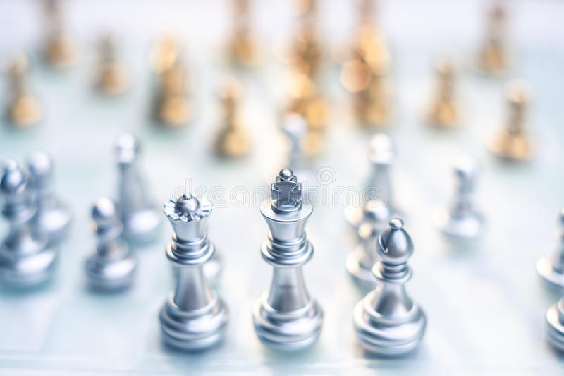 Chess game. A king stand determinedly among the enemies. Business competitive concept. Achievement adrenaline ahead ambition brave challenge champion chance stock photo